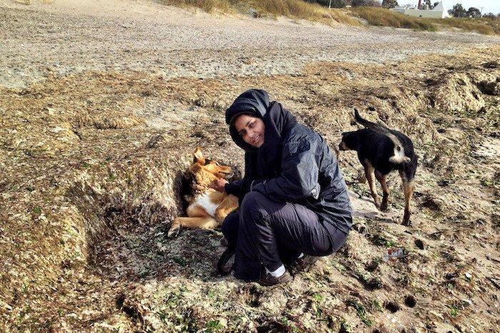 Teena with street dogs